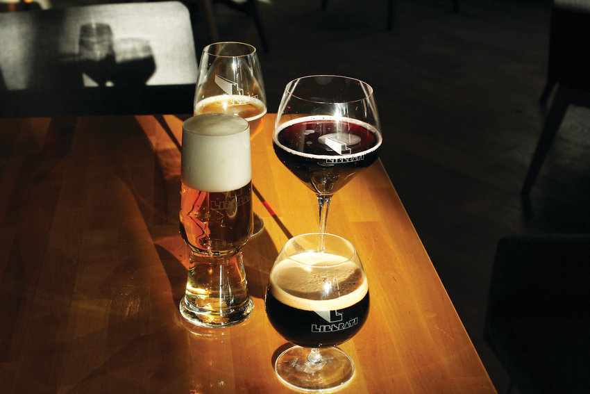 The glassware at Liberati helps bring out the flavor of the individual grape beers. The brewery and restaurant opened last month in Five Points.