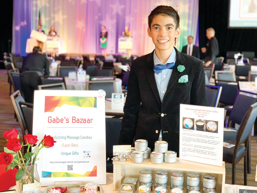 Gabe Nagel, owner of Gabe's Bazaar, sells his products at a gala put on by the Young Americans organization. Nagel typically does business at events like this one and has also sold his products in a number of retail locations.