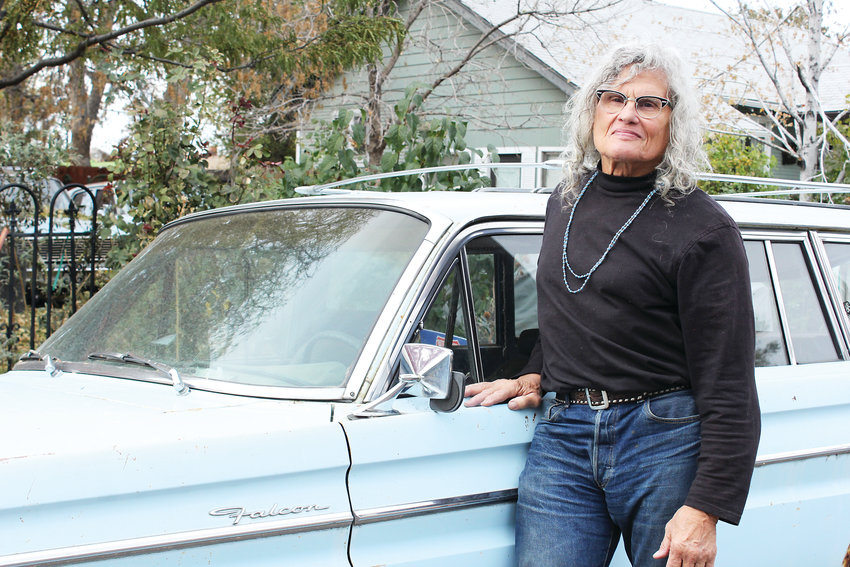 Overland Park resident Ronnie Crawford stands with one of his Ford Falcon cars. Crawford has lived in Denver since 1976 and owned several vintage stores on Broadway.