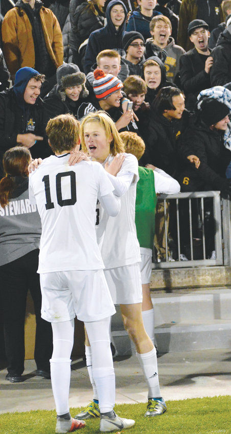 Arapahoe players celebrate after a 2-1 win over Grandview on Nov. 9 gave the school its sixth boys soccer championship but the first one since 1997. The Warriors finished the season with a 17-1-2 record.