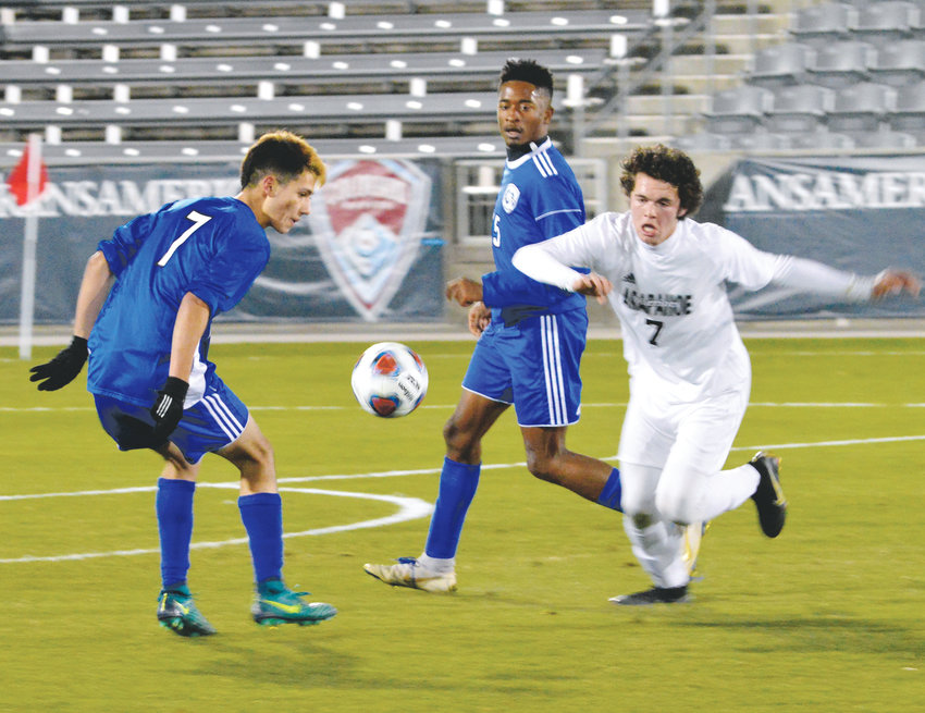 Arapahoe's Cameron Gail (7) and Jose Raya (7) of Grandview track down a loose ball during the 5A state championship game Nov. 9 at Dick's Sporting Goods Park. Gail assisted on the winning goal as the Warriors downed the Wolves, 2-1.