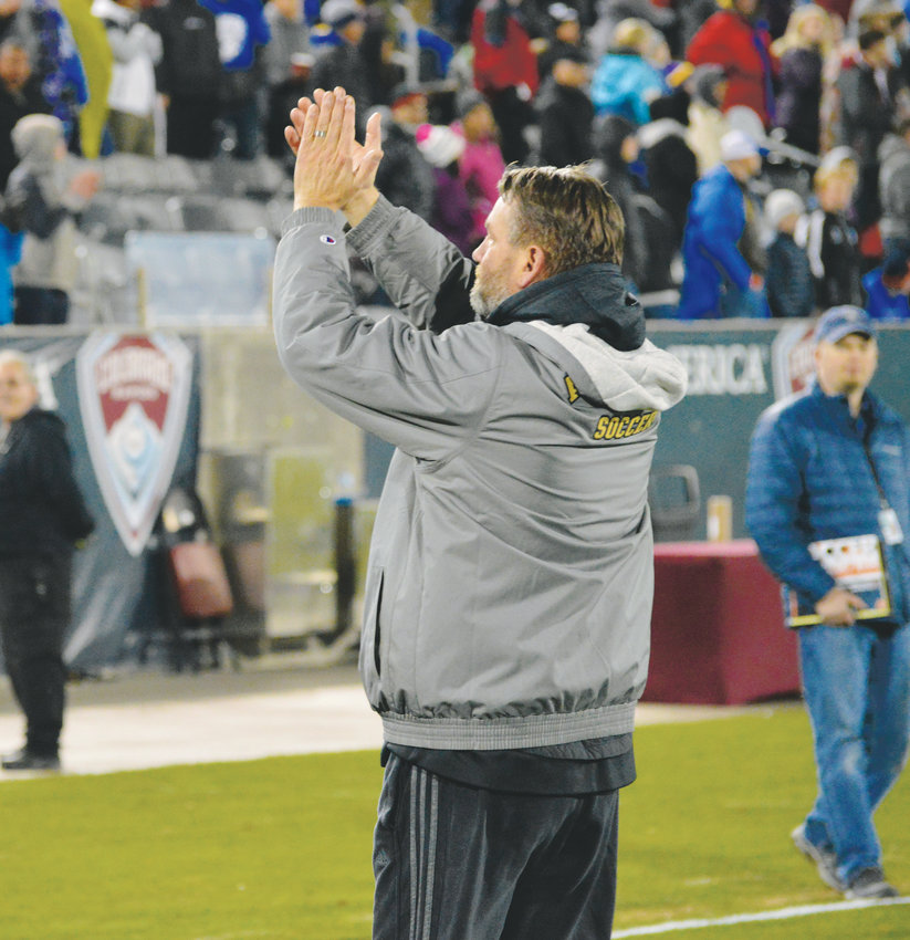 Arapahoe coach Mark Hampshire acknowledges the Arapahoe crowd that showed up at Dick's Sporting Goods Park on Nov. 9 to support the Warriors who won the 5A state championship with a 2-1 victory over Grandview.