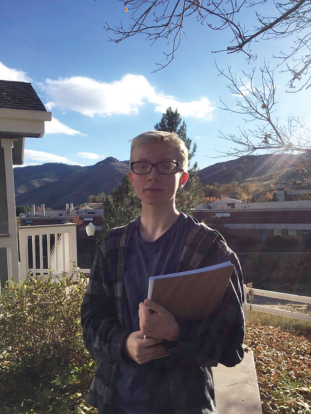Goldenite Codey Carr, 15, visits homes in Golden on Oct. 18 to rally support for Golden's ballot question 2E, which proposed to lower the voting age to 16 for municipal elections.