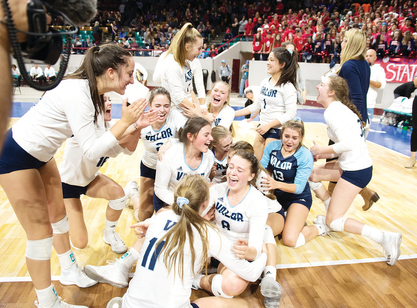 The Valor Christian volleyball team ends up on the floor as the players celebrate their first State Championship after defeating Chaparral 3-1 on Nov. 10 at the Denver Coliseum.