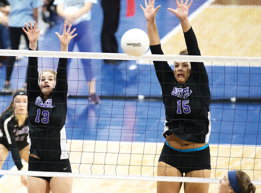 Lutheran's Kennedy Johnson (13) and Avery Anderson get in the successful block. The Lions ended up on top winning the state championship on Nov. 10.