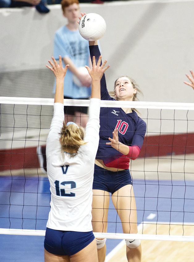 Chaparral's Morgan Riddle (10) lines up her kill as Valor Christian's Courtney Lane readies for the block.