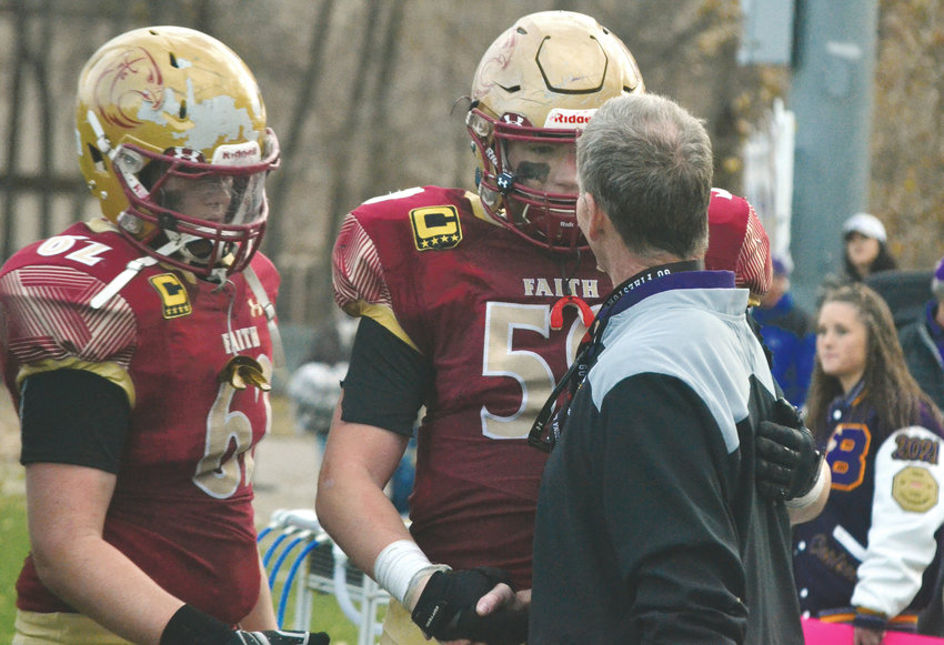 Faith Christian senior lineman Jacob Theilen (59) receives congratulations from Bayfield head coach Gary Heide, after the 9-seed Eagles pulled off a 21-13 upset of the #1 Wolverines in Arvada this past Saturday, Nov. 10.