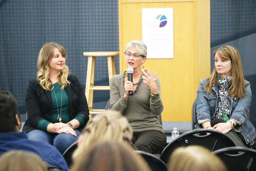 Lissa Miller, left, Jeannie Ritter and Maureen Lake share their experiences with mental illness at the second Time to Talk community forum at James H. LaRue library in Highlands Ranch. About 50 people attended the Nov. 14 event.