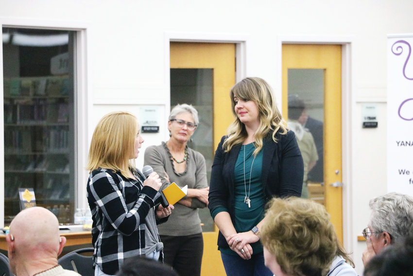 Parent Sarah Goyette, left, asks Lissa Miller for advice on how to find the right type of help. The women connected at the second Time to Talk forum on Nov. 14 at James H. LaRue library in Highlands Ranch.
