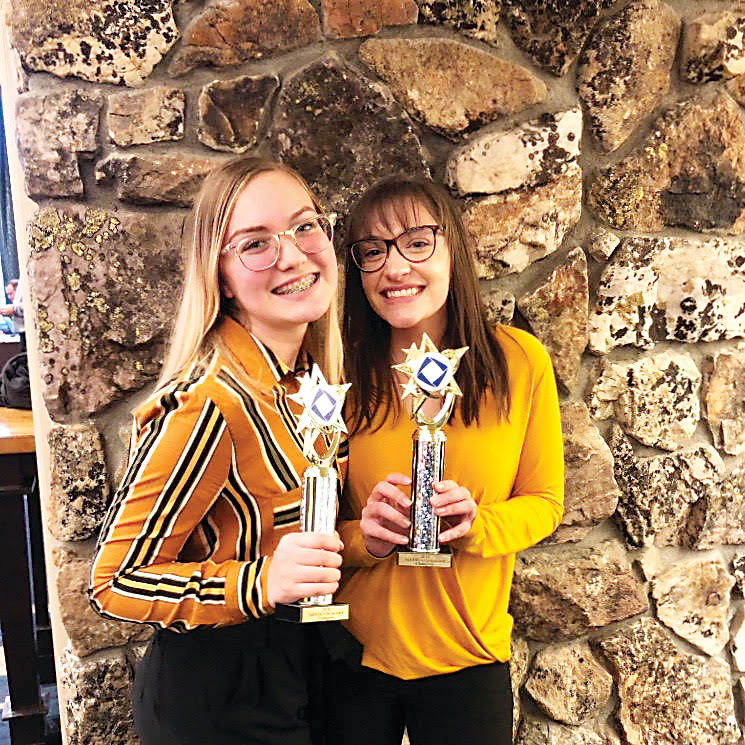Faith Bochert, 16, left, and Talia Rotella, 17, are juniors at Mountain Range High School's High School of Business and represent the school at DECA business competitions.