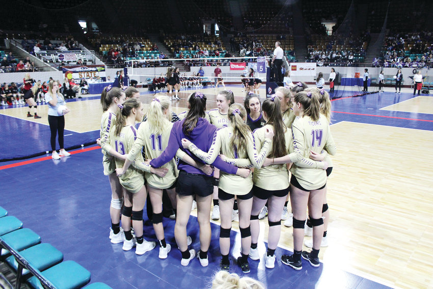The Holy Family volleyball team gathers together during a timeout against Silver Creek in the first round of the 4A state tournament at the Denver Coliseum.