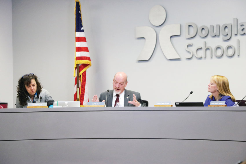 "Douglas County Board of Education Vice President Wendy Vogel, left, president David Ray and member Krista Holtzmann talk compensation at a Nov. 13 school board meeting in Castle Rock. ""Is there an employee that is going to look at this and say this is unfair?"" Ray asked."