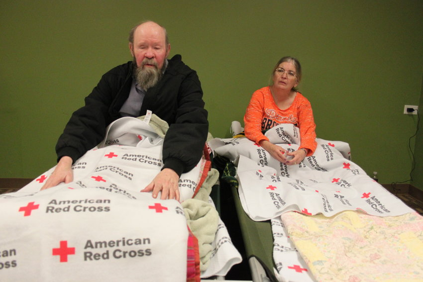 Ray Hays, left, and his caretaker Carla Baker spent the night on cots in a Red Cross shelter after a fire forced them out of the Windermere apartments on Nov. 17. Hays, who is blind and half deaf, returned to the complex after being evicted following a 2016 fire. Photo by David Gilbert