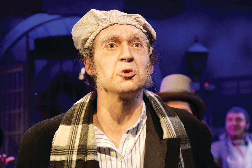 """Humbug!"" Stephen Turner performs as Ebenezer Scrooge in Town Hall's ""A Christmas Carol: The Musical."""