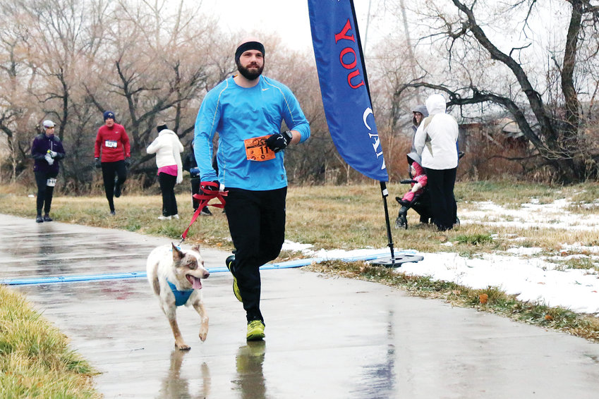 Anthony Ames, 33, was one of many runners to bring their canine companion on the course with them.
