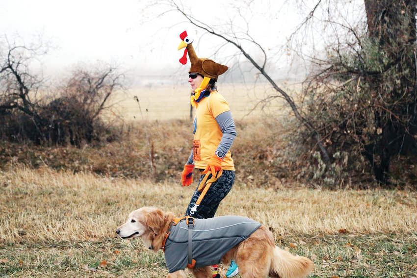 Amy Young prepares to run the 10K Turkey Trek in Arvada with her dog.