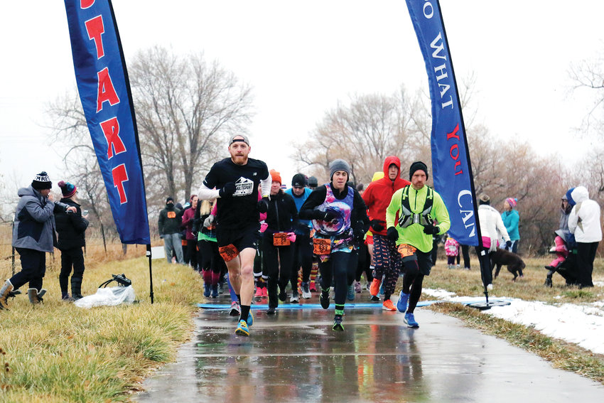 Over 400 runners braved freezing rain to participate in a 10K, 5K or 2K run at the Turkey Trek in Arvada Nov. 17.