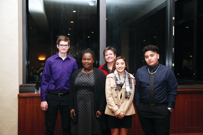High school awards and scholarship winners Isaac Mohr, Maxlene Augustin, Adrena Rocha and Kenneth Godoy pose with Andrea Hart, Chair of the Jeffco Schools Foundation.
