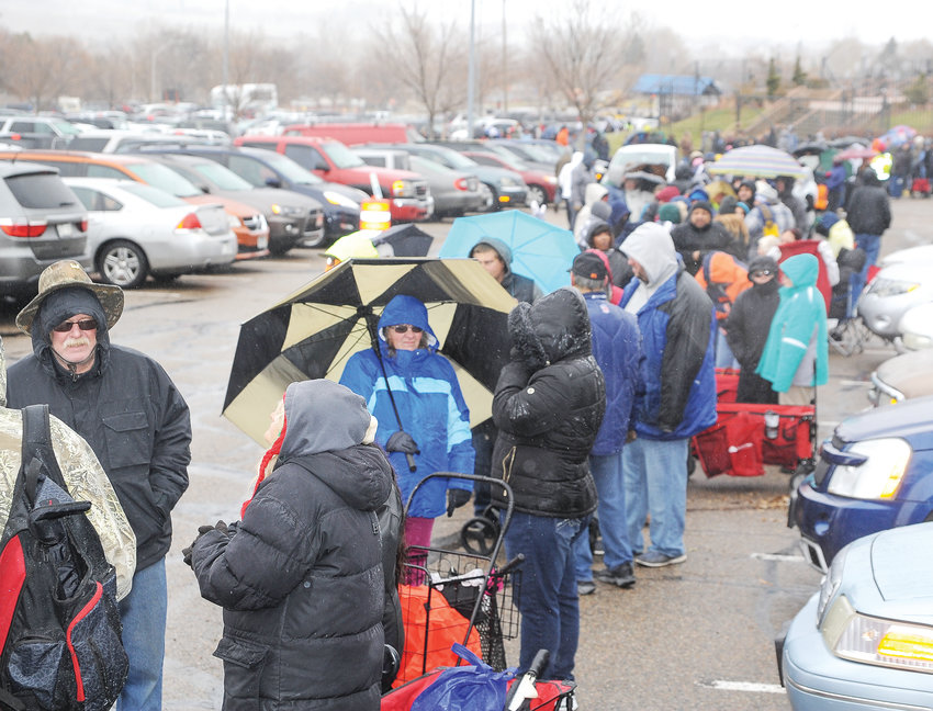 Several thousand brave freezing drizzle and 26 degree temperatures to line up and receive free turkeys, courtesy of the Adams County Sheriff's Department on Nov. 17 at Water World in Federal Heights.