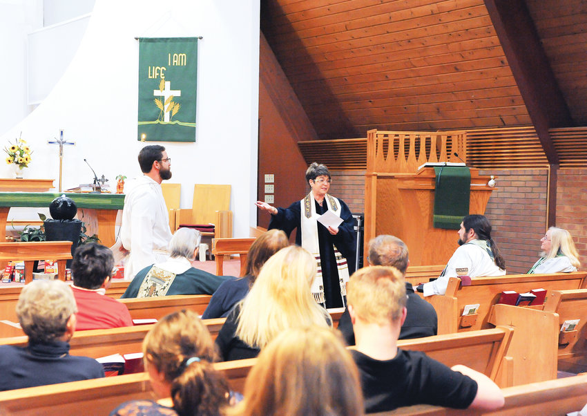 Westminster clergy Anat Moskowitz, right, of Congregation B'nai Torah, and Vicar Nic Leither, of Advent Lutheran Church, discuss the true meaning of Thanksgiving, during an interfaith service Nov. 19 at Advent Lutheran Church.