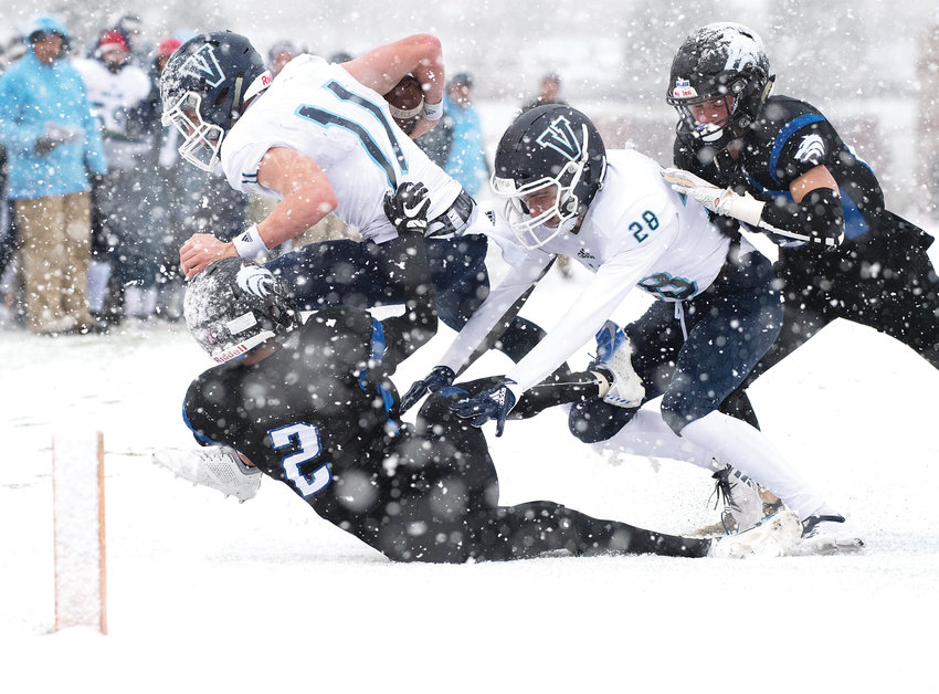 Valor Christian's Jack Howell (11) gets forced out of bounds just before the goal line marker as Grandview defenders Quentin Goodgain (2) and Kyle Trumble (23) along with Howell's blocker Dane Pallazo (28) follow him out. Despite near-white out conditions in the second half, the Eagles ended up on top to get the 31-29 victory, punching their ticket for the Dec. 1 5A state championship game at Broncos Stadium at Mile High.
