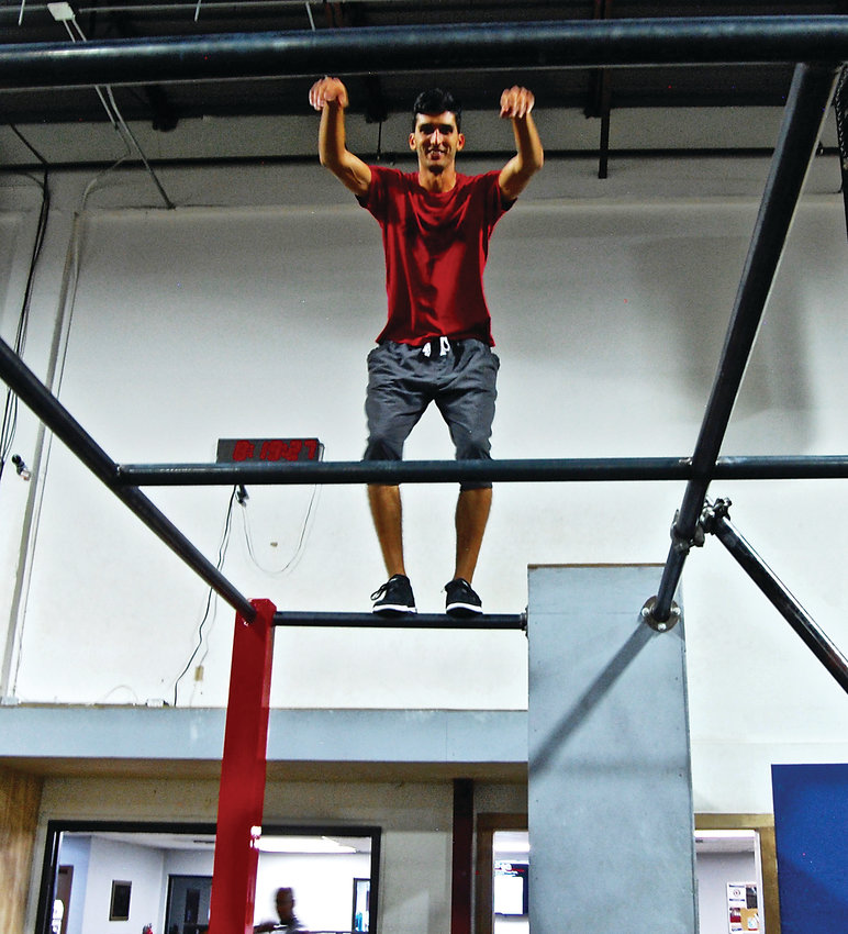 Vinny Fiacco on the rails at APEX Movement, the parkour gym in Denver at which he is co-owner and general manager.