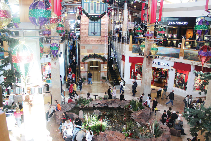 Shoppers scour Park Meadows mall for Black Friday deals Nov. 23. Pam Kelly, general manager of the mall, said the mall spent about $1 million on decorations for the holiday season.