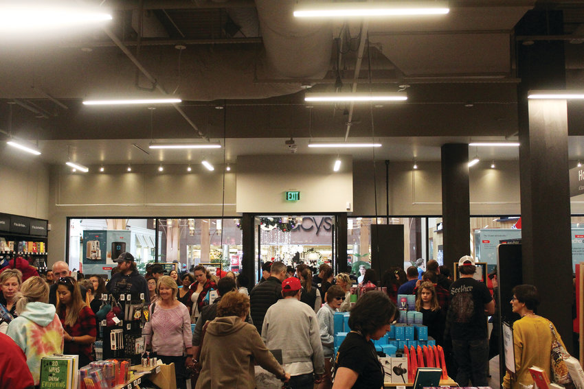 Shoppers crowd the Amazon 4-Star store at the Park Meadows mall, the newest addition to the state's largest indoor mall. Pam Kelly, general manager of the mall, said this year was the busiest Black Friday the mall has ever seen.