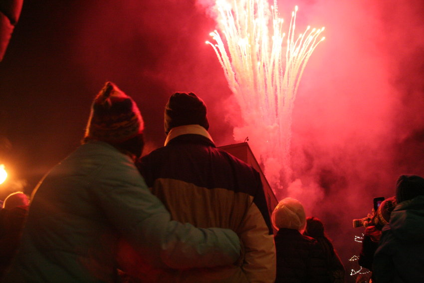 Harmony Fiisher and Lowell Kalman, both Colorado School of Mines students watch the fireworks display off the roof of the Golden Hotel.