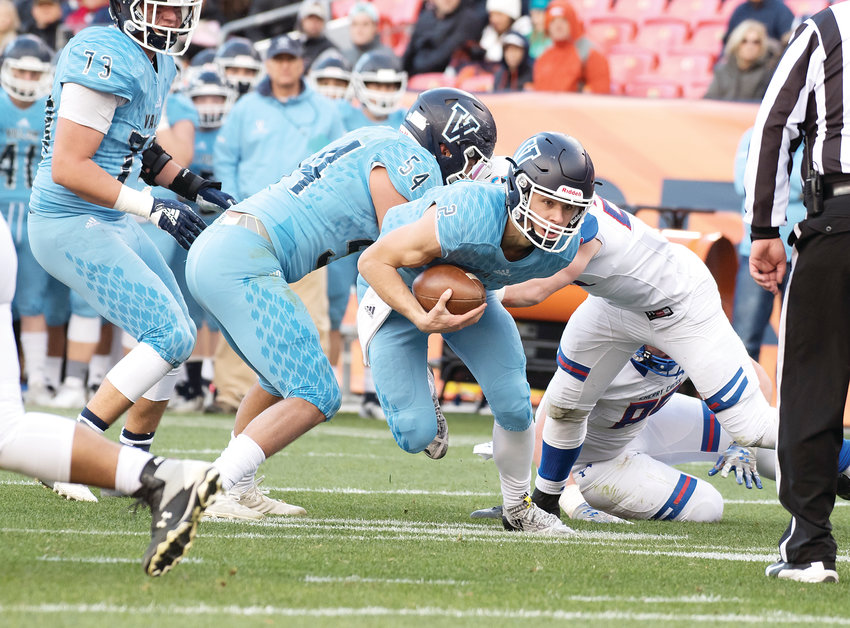 Valor Christian quarterback Luke McCaffrey runs the ball as teammate Ethan Zemla (54) seals off a potential tackler against Cherry Creek in the 5A state championship game on Dec. 1.