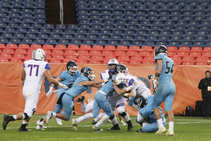 Valor defenders swarm in to stop Cherry Creek running back Shamus Henderson during the Dec. 1 Class 5A state championship game.