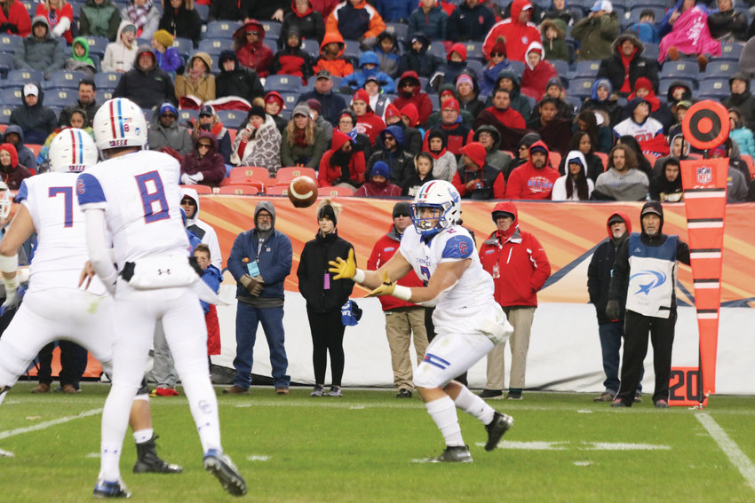 Cherry Creek quarterback Alex Padilla throws a swing pass to running back Jayle Stacks during the Dec. 1 Class 5A state championship football game against Valor Christian.