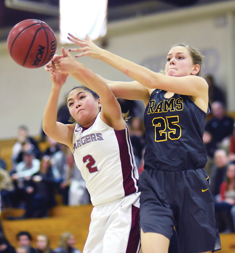 Chatfield senior Bailey Truex (2) and Green Mountain junior Maddie Phillips (25) go after a loose ball Nov. 30 during the Chargers' 60-54 victory. The Rams scored 25 points in the final quarter, but it wasn't enough to overcome the 20-point deficit.