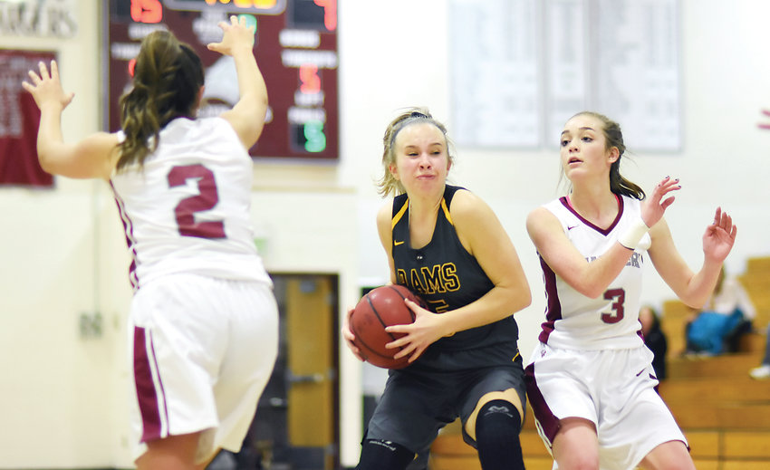 Chatfield seniors Bailey Truex (2) and Emma Talbot (3) attempt to cut off Green Mountain senior Savannah Hapke's path to the basket Nov. 30 at Chatfield High School. Hapke and sophomore Courtney Hank led the Rams combining for 39 points in the 60-54 loss to the Chargers.