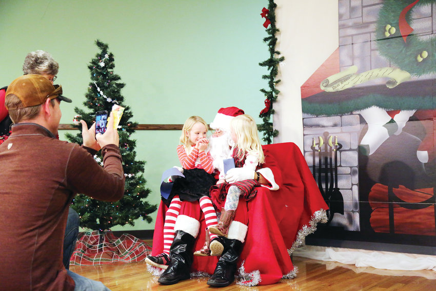 Children gathered for a chance to sit on Santa's lap at the Apex Community Rec Center Dec. 1.