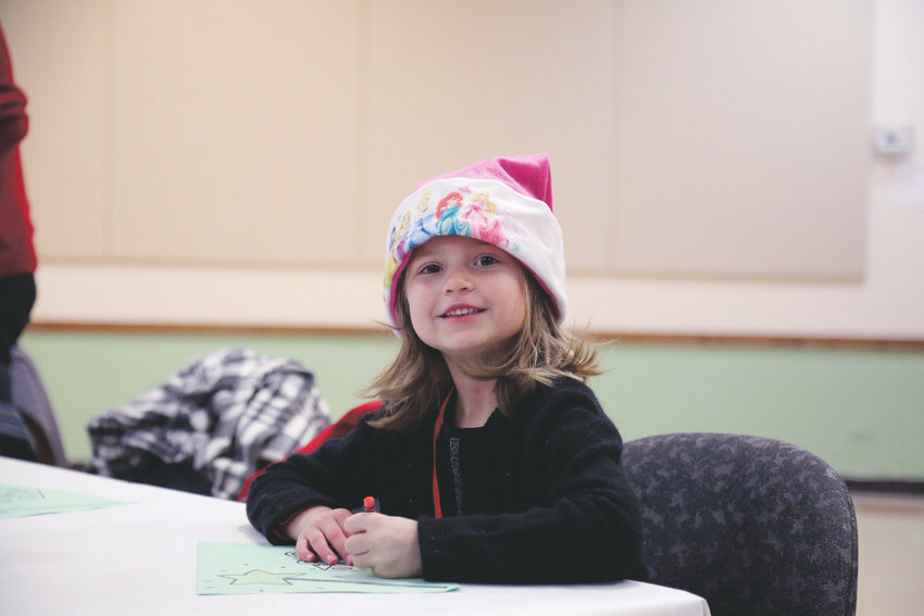 Lila St. Martin colors before the Santa Breakfast Dec. 1 at the Apex Community Center.