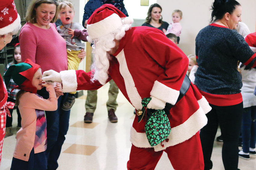 Santa pinches noses as he makes his way to his chair at the Dec. 1 Santa Breakfast.