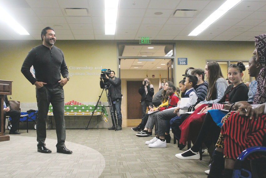 Vinny Castilla, former major league baseball player for the Colorado Rockies, gives a speech to a group of children preparing to become naturalized citizens. Castilla, from Mexico, received his Certificate of Citizenship through naturalization in October and spoke about the opportunities living in America has provided him.