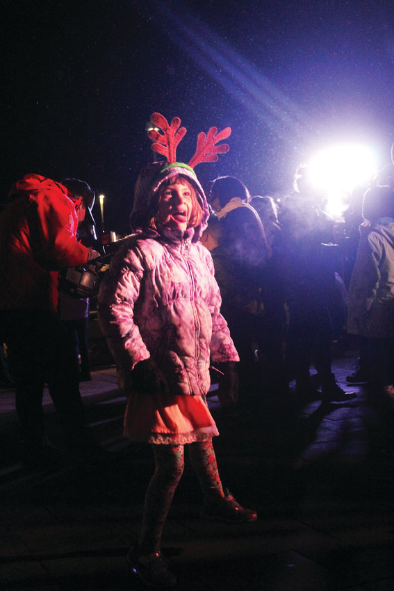 Brooke Weaver dances to Christmas music at the Lone Tree tree lighting ceremony at the Lone Tree Arts Center Nov. 30.