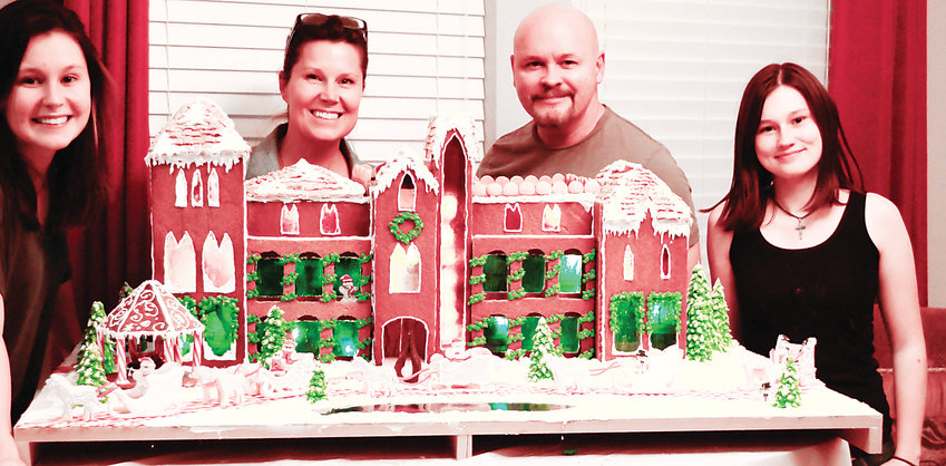 The Smith family of Castle Rock stands with their Great Gatsby-themed gingerbread house. It will be on display at the Colorado Christmas Adventure event, which takes place Dec. 7-8 at Mission Hills Church Littleton Campus, 620 Southpark Drive.