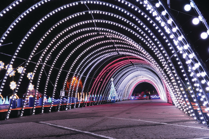 "A long archway of Christmas lights are tested at Water World Nov. 29 in Federal Heights. The lights are part of the facility's ""Christmas In Color"" display, which had been blown down during last weekend's snowstorm and had to be reconstructed."