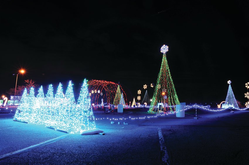 "Water World's Christmas lights are tested Nov. 29 ahead of the formal Nov. 30 opening. Much of the ""Christmas in Color"" display in Federal Heights had blown down during the Thanksgiving weekend snowstorm and had to be rebuilt."