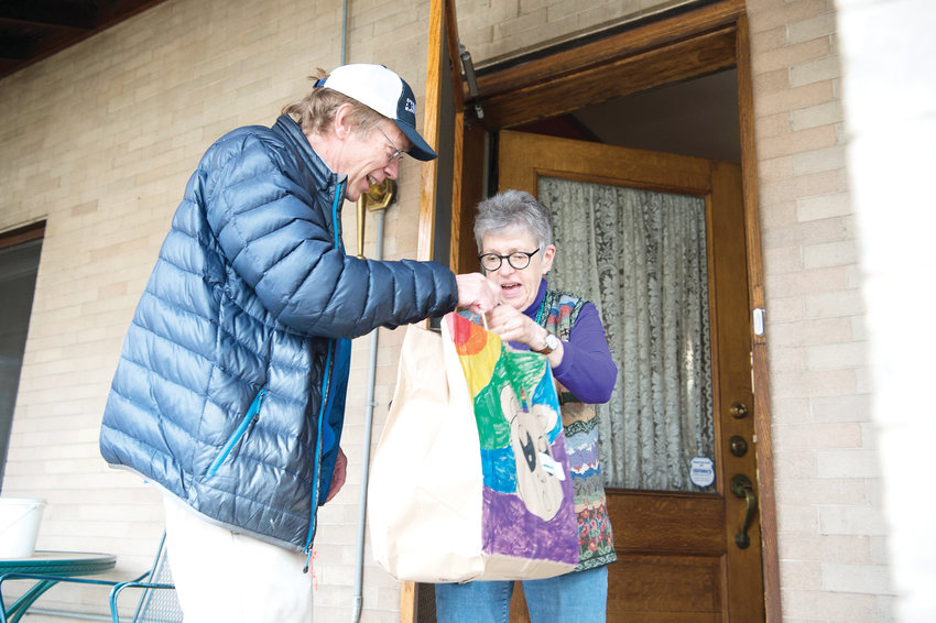 Ernest Tucker, who works in National Renewable Energy Laboratoryâs (NREL) communications and public affairs department, delivers meals to Julie, a Denver resident whose husband is a Project Angel Heart client.