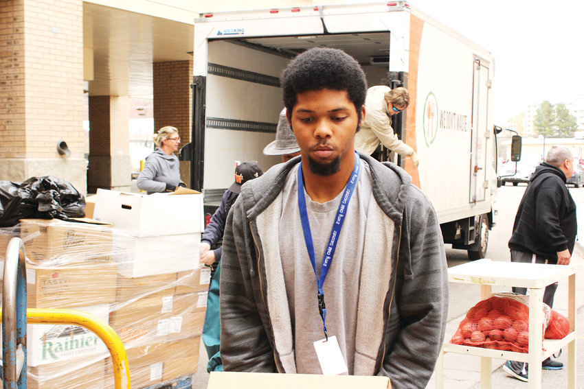 Jaleel Harding, a parateacher at West Leadership Academy, helps to unload produce off of the We Don't Waste truck. The nonprofit donates produce and other perishable food items to the West High School food bank.