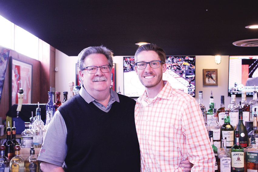 Dan Nickless, left, and his son Jeff stand behind the bar at Campus Lounge. The pair recently bought the 70-year-old restaurant and bar, which has been a staple to the Bonnie Brae neighborhood for decades.