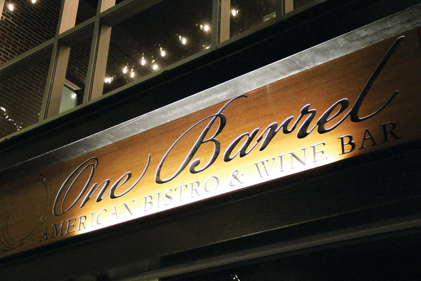 The sign above the door at One Barrel welcomes visitors to the newly opened wine bar and restaurant on the ground level of the Broadway Lofts apartment building at 3401 S. Broadway in Englewood.