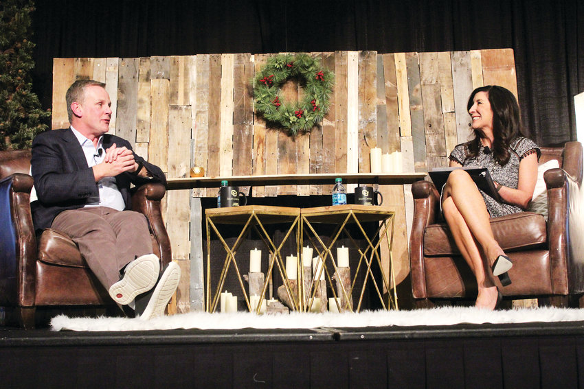 Crocs CEO Andrew Rees talks with Lone Tree Mayor Jackie Millet during a CU-South Denver seminar series Nov. 29.
