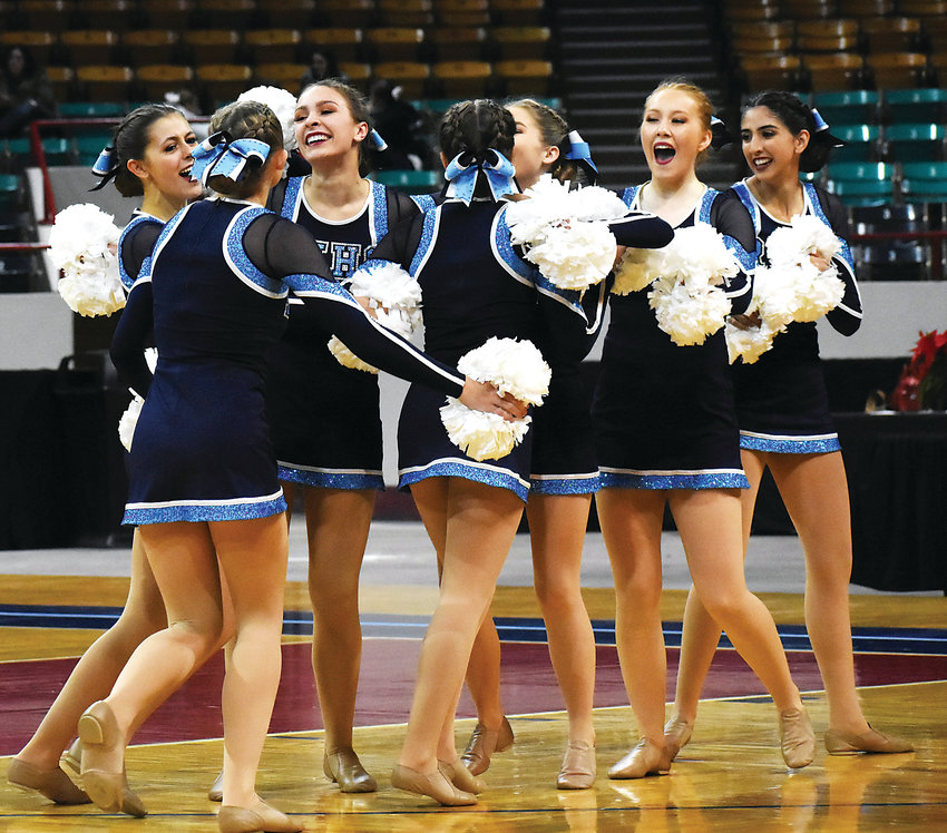At left, Ralston Valley High School's poms team celebrates after its performance Dec. 8 during the preliminaries of the Class 5A poms competition. Ralston Valley placed 11th.