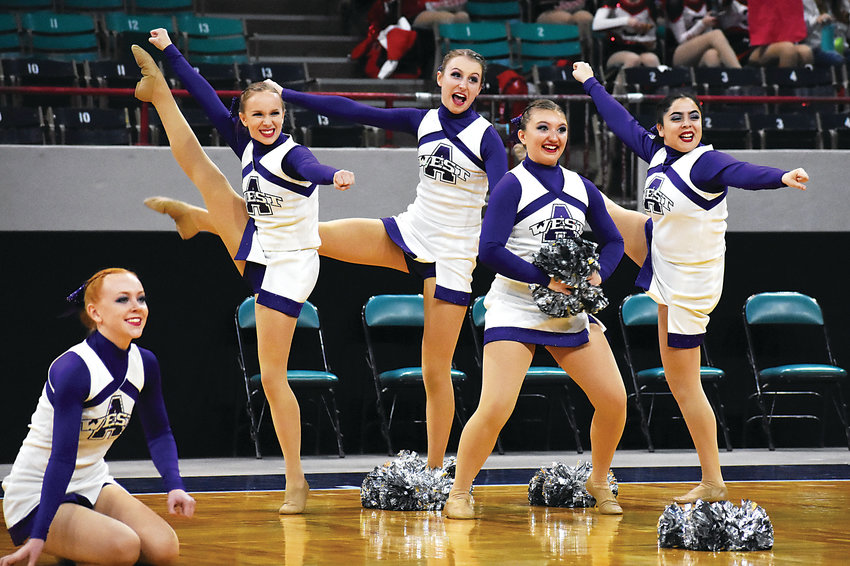 Arvada West High School's poms team performs during the Class 5A poms preliminaries during the spirit state championships Dec. 8, at the Denver Coliseum. Arvada West placed 21st.