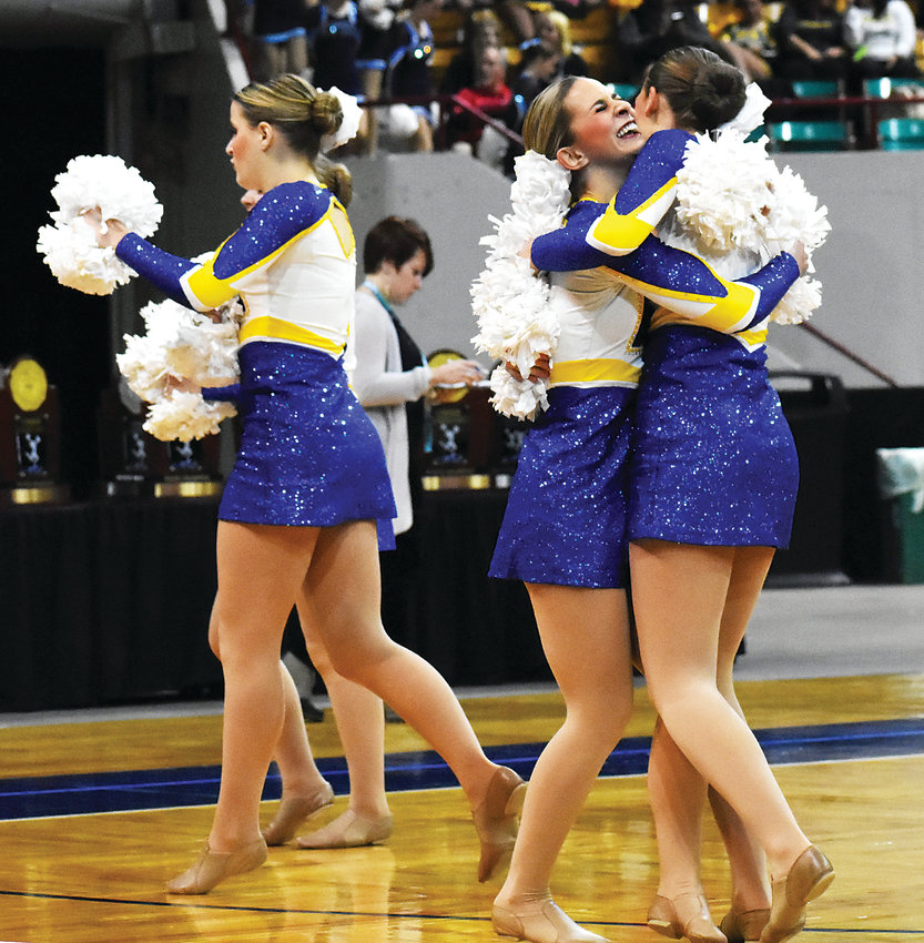 Wheat Ridge High School's poms squad celebrates after its preliminary performance at the spirit state championships Saturday, Dec. 8, at the Denver Coliseum. The Farmers were going for their third straight Class 4A poms state title, but were edged out by league rival Standley Lake. Wheat Ridge ended up placing third.